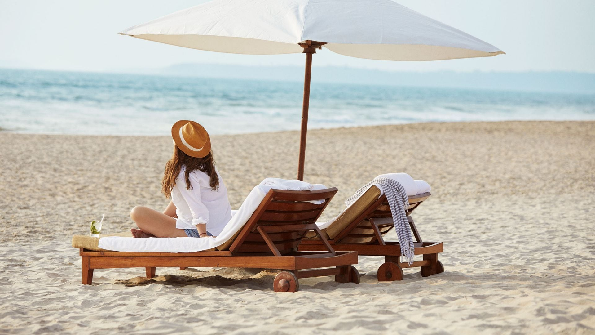 Woman on Beach Lounge Chair