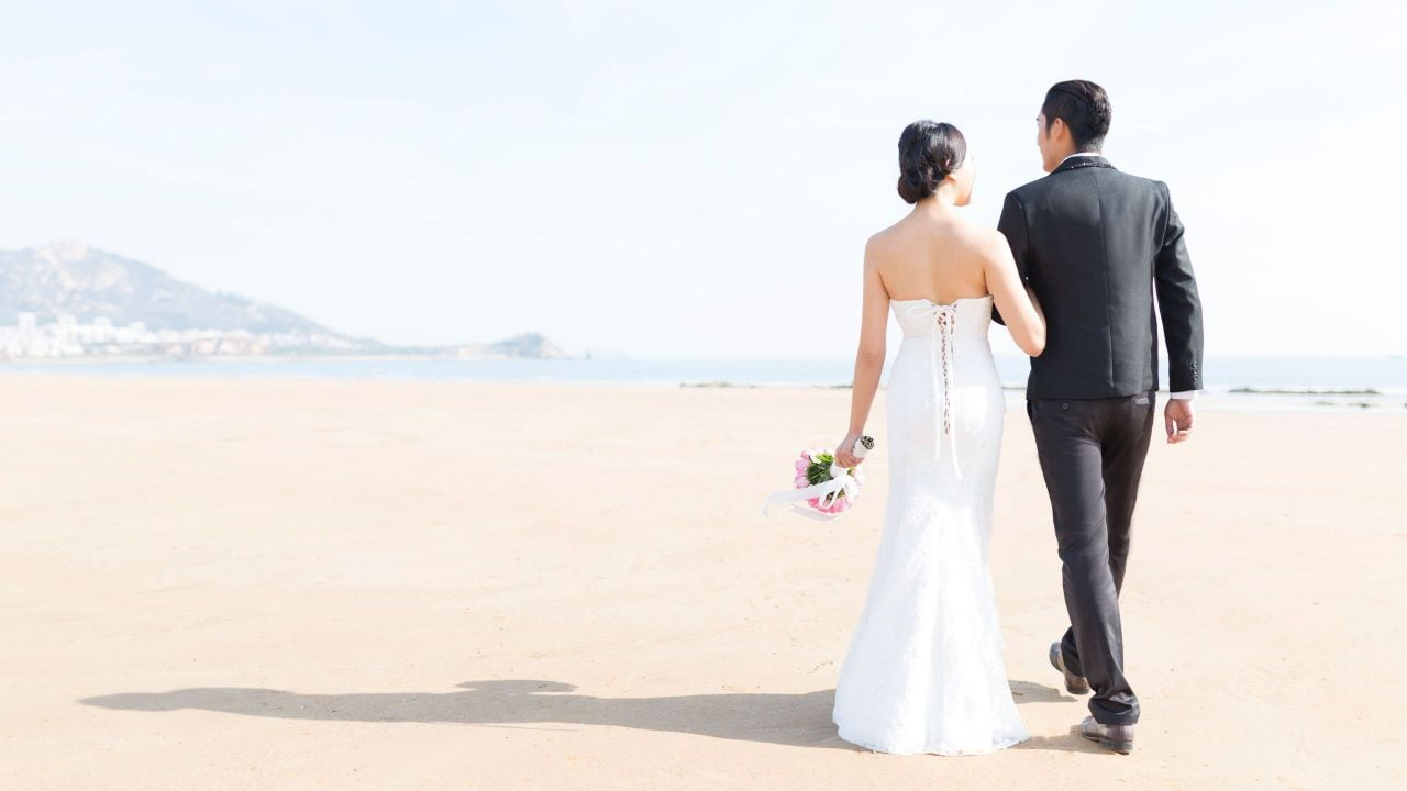 Wedding Couple Walk on the Beach