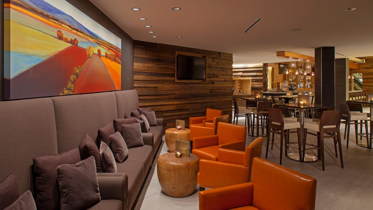 Couches, armchairs and tables in hotel bar