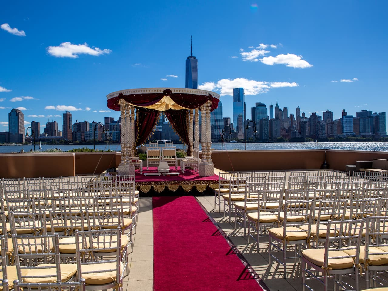 Outdoor wedding venue with the New York City skyline in the background