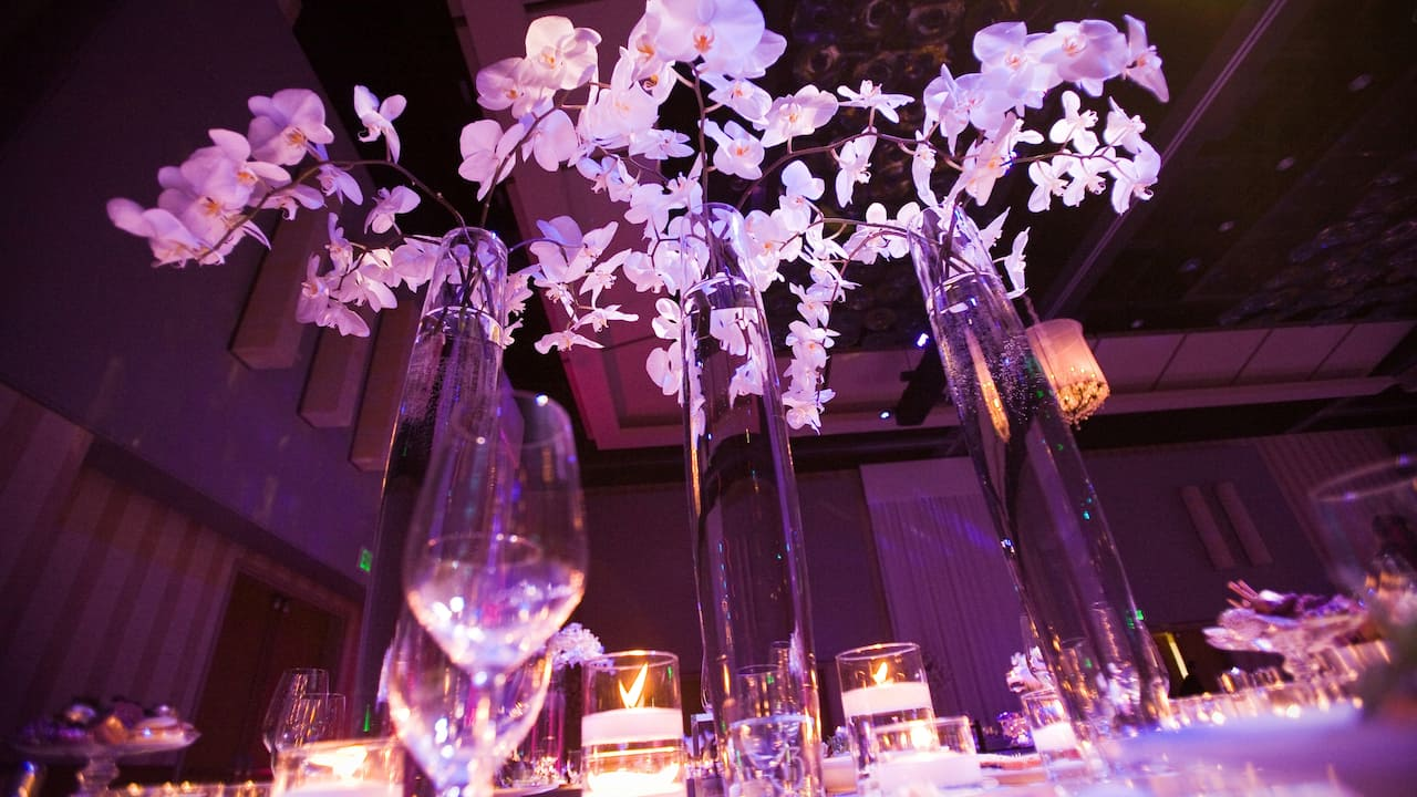 A white orchid centerpiece at a wedding ceremony