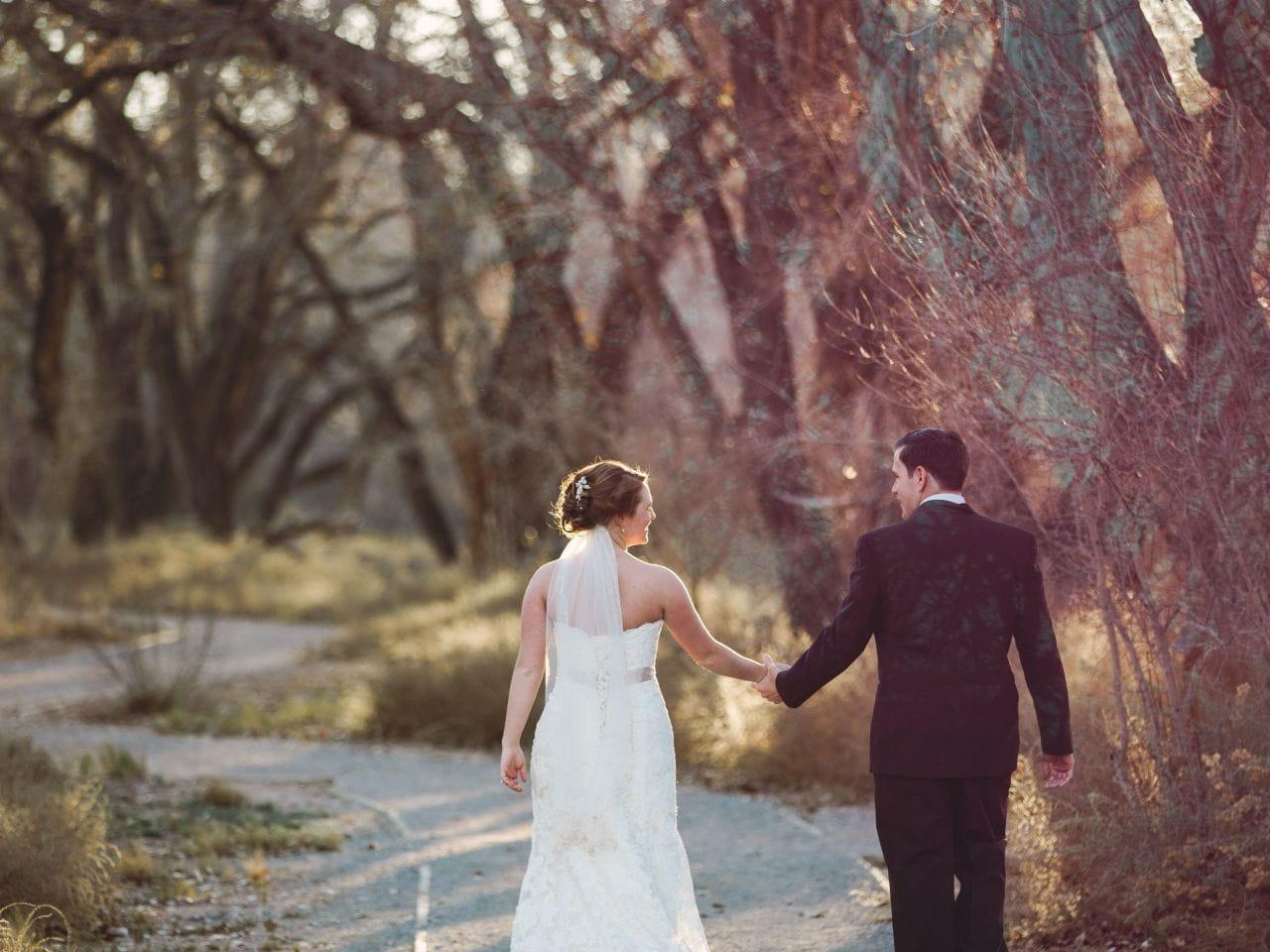 Wedding Bride and Groom walking Hyatt Regency Tamaya Resort & Spa