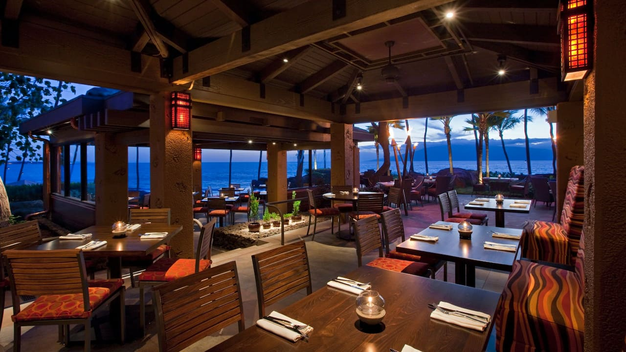 Intimate dining area near the ocean in Maui