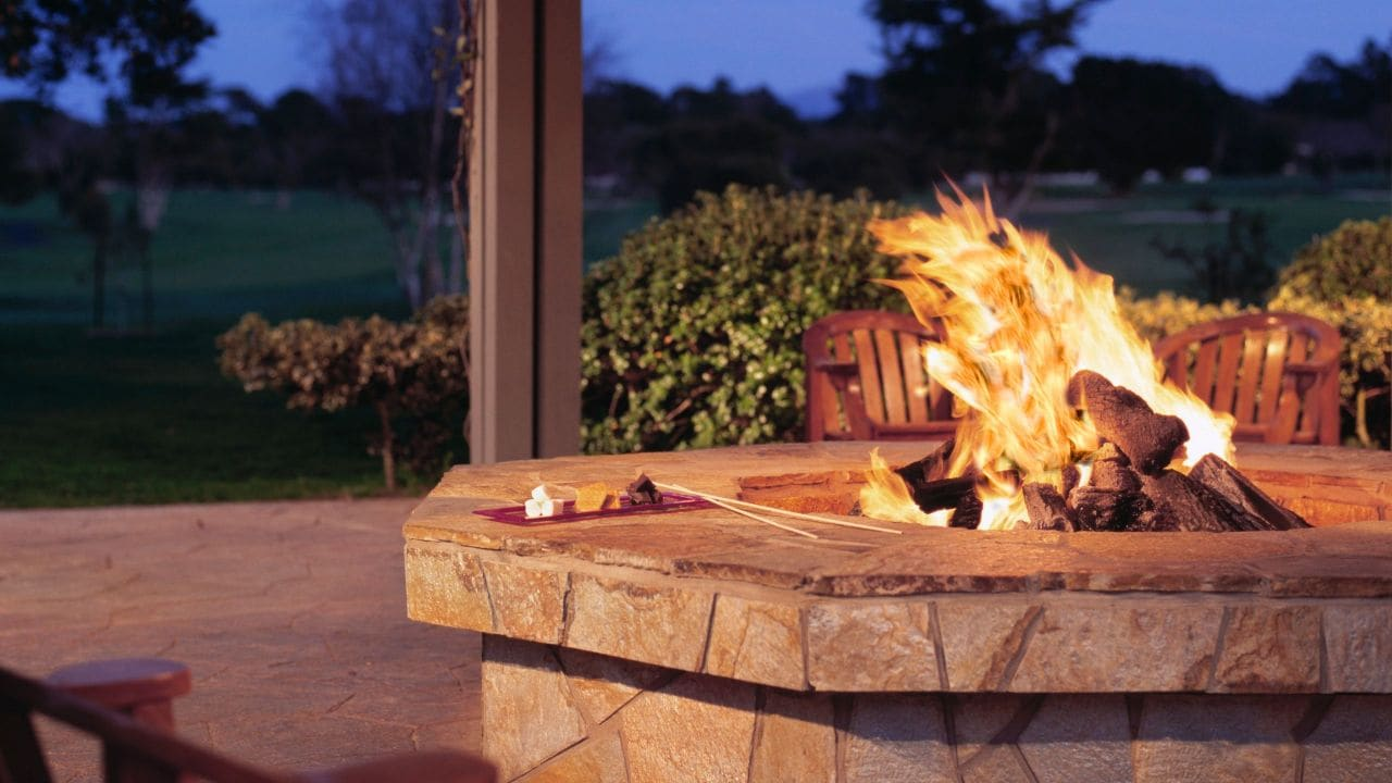 Cozy outdoor fireplace with smores