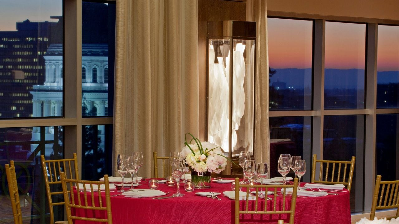 Ballroom table detail with capital view at sunset