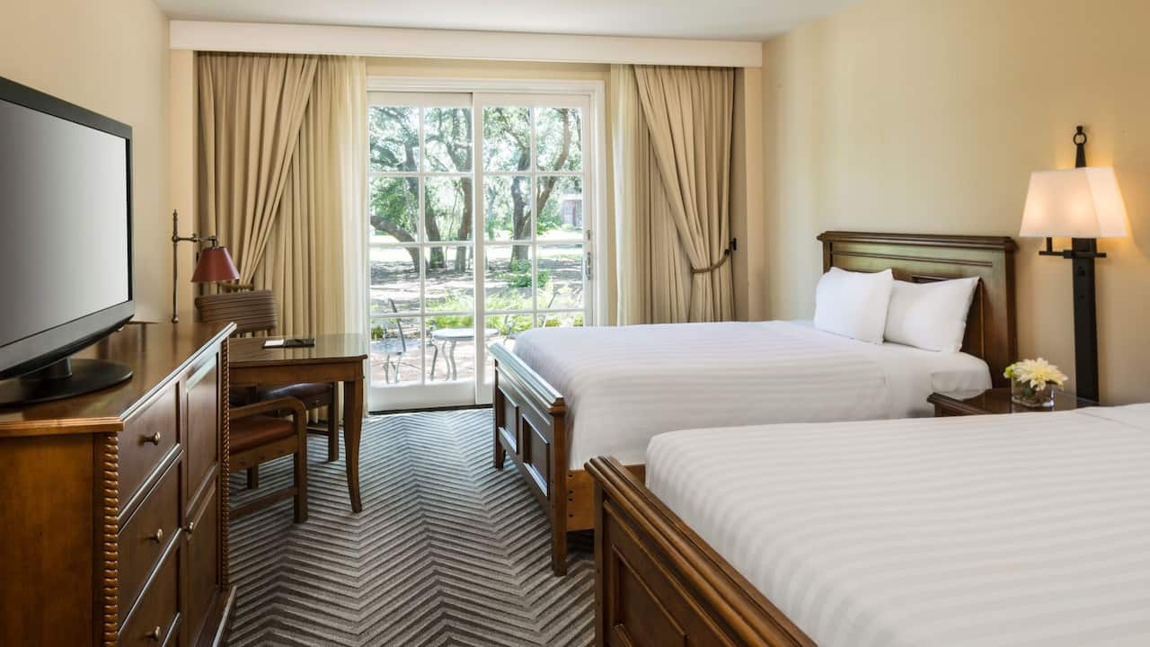 Double guest room with outdoor patio at Hyatt Regency Hill Country Resort & Spa