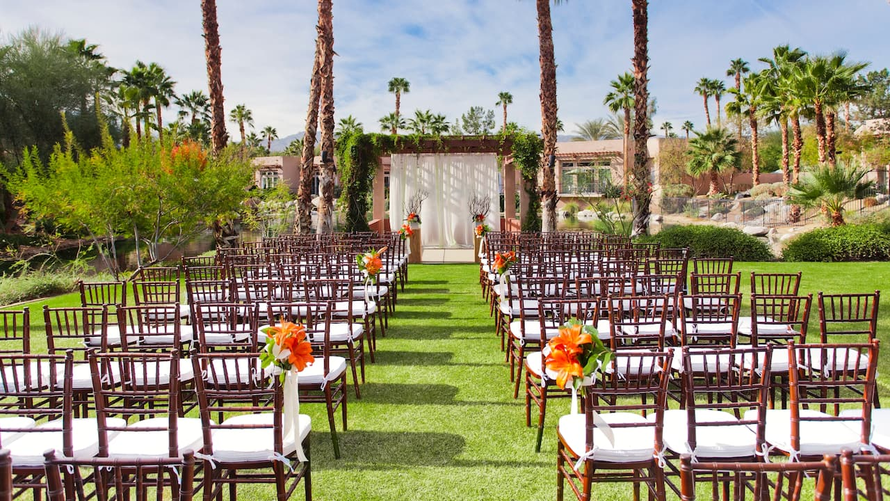 An outdoor wedding ceremony with organized seating in Palm Springs at Hyatt Regency Indian Wells Resort & Spa