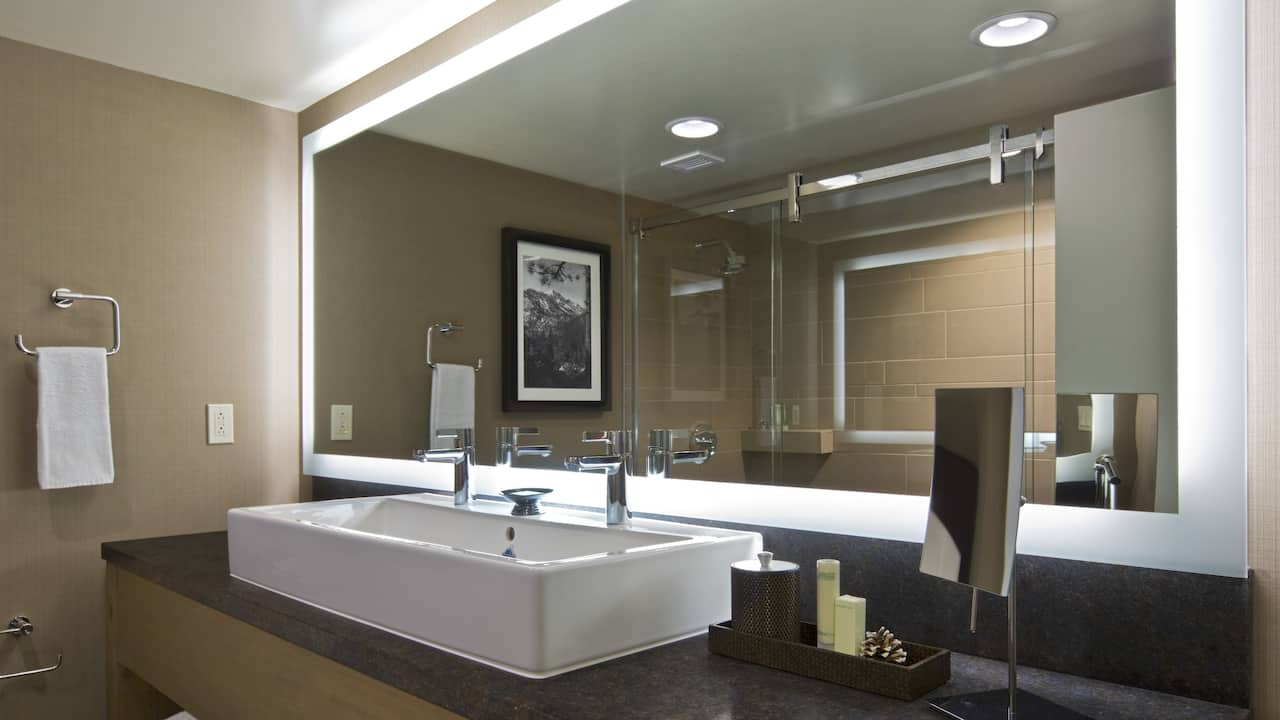 Executive king bathroom with a large vanity mirror