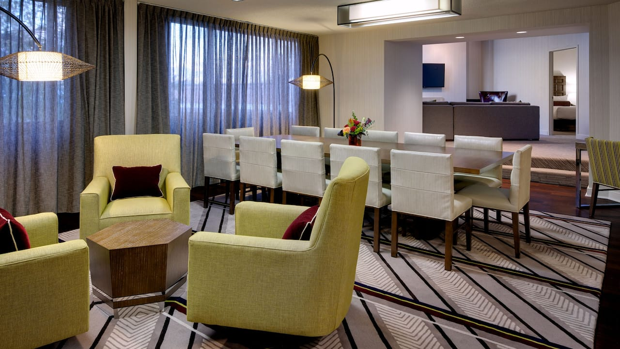 Armchairs, dining table and chairs in hotel suite