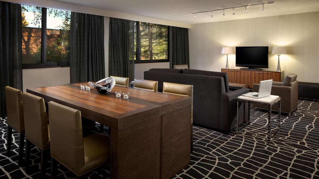 Dining and living areas in hotel suite