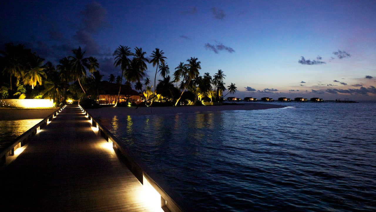 luxury maldives resort Arrival Jetty at Night