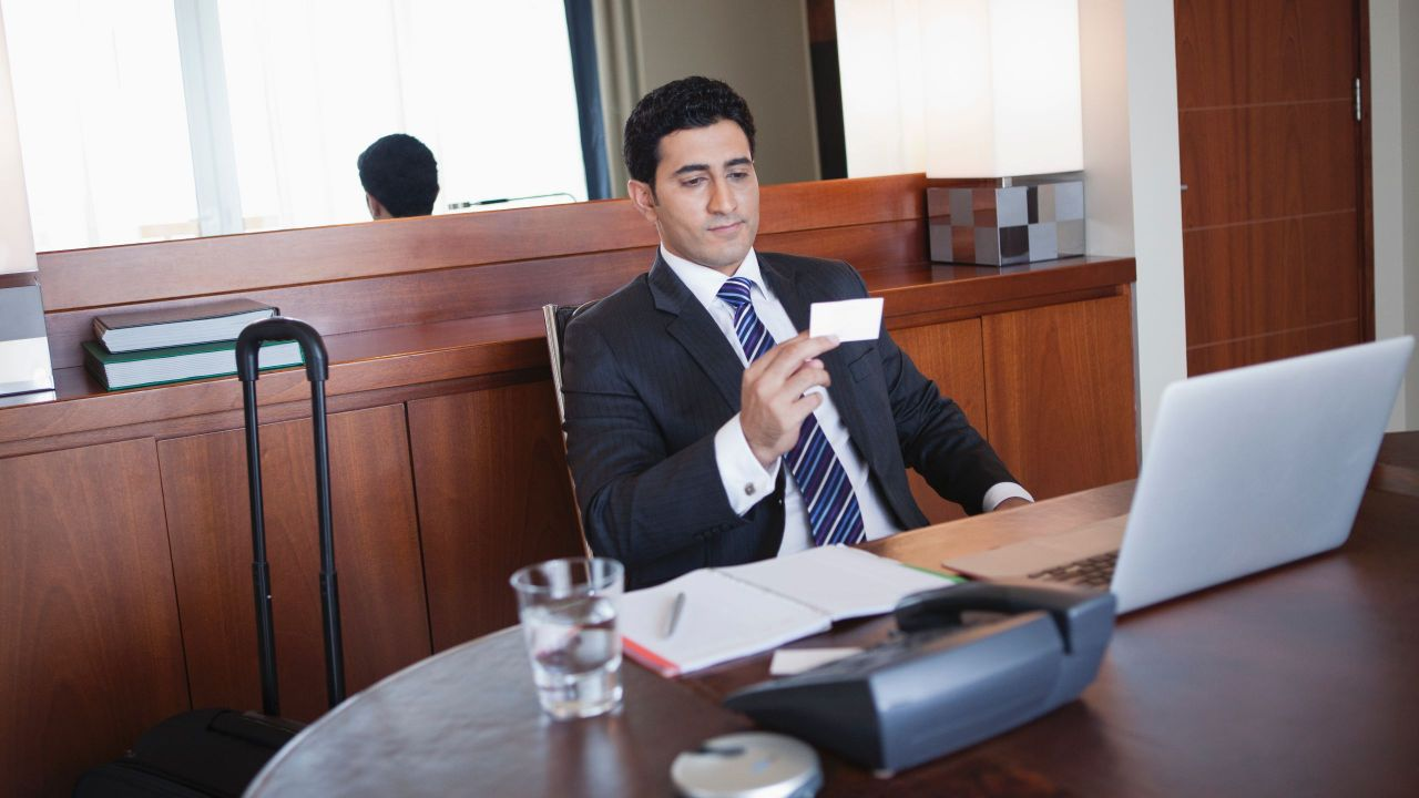 Man Looking at Business Card