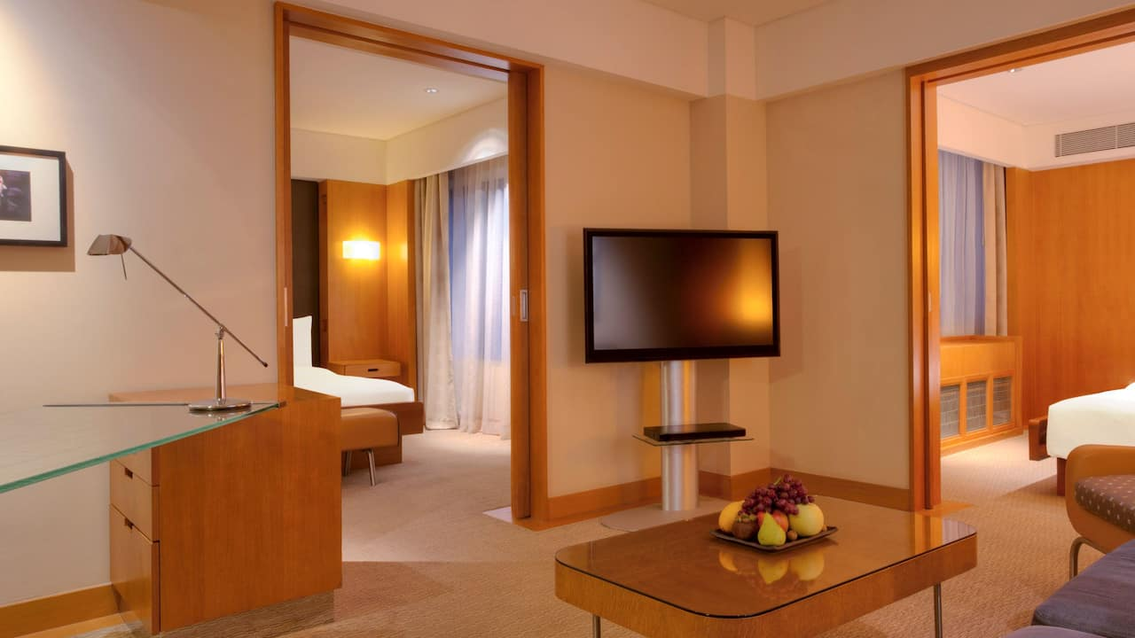 Two bedroom Grand Deluxe garden view (1 King/2 Twin beds) Grand Hyatt Singapore
