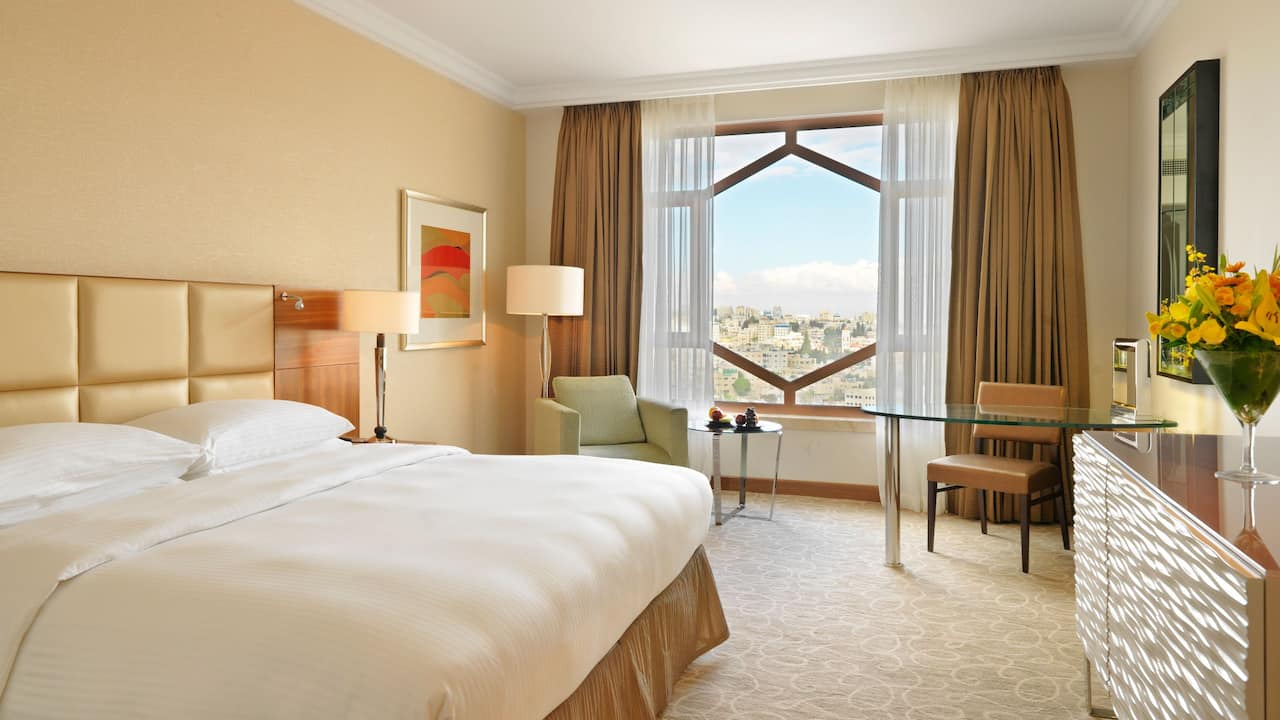 King Bedroom with Pool View at Grand Hyatt Amman