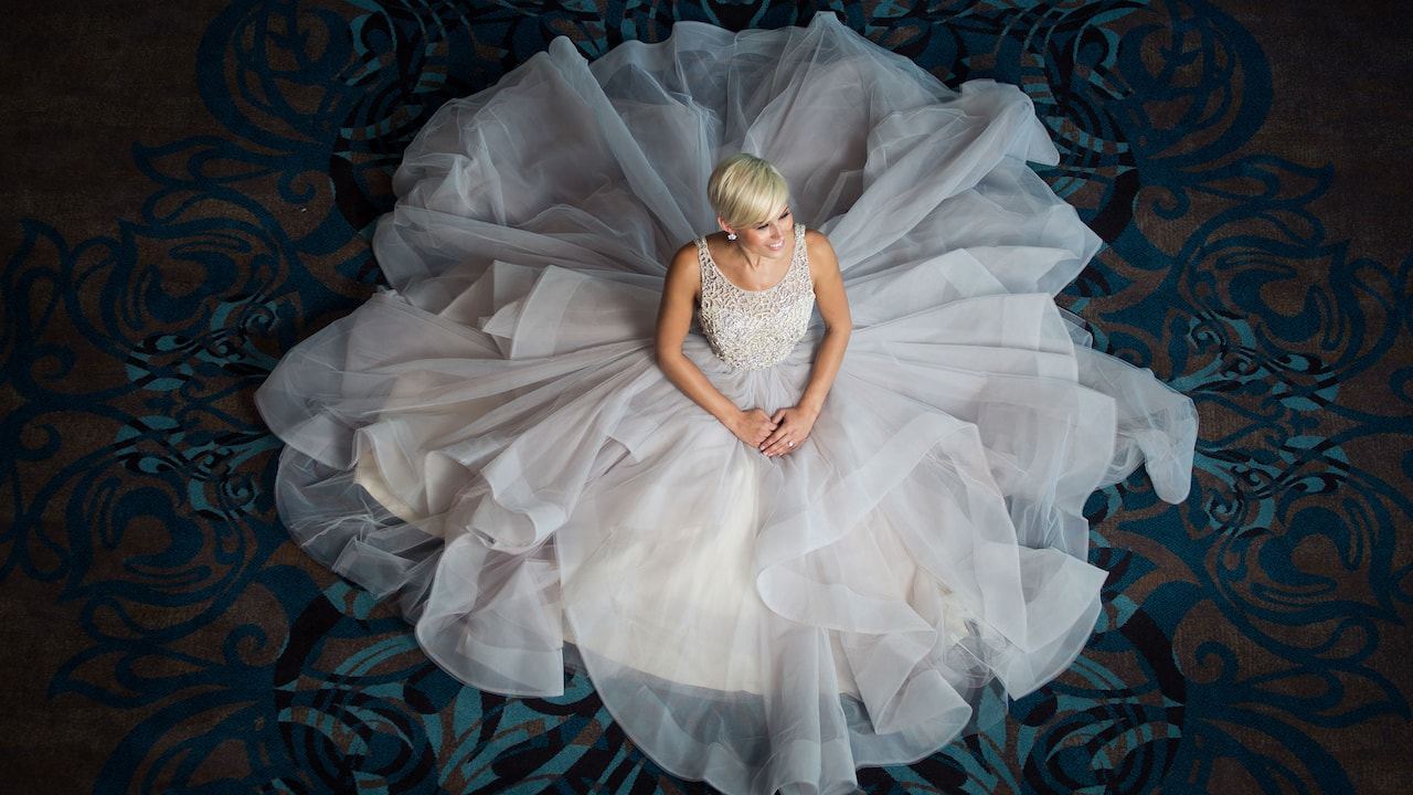 Bride sitting in the Hyatt Regency Austin ballroom