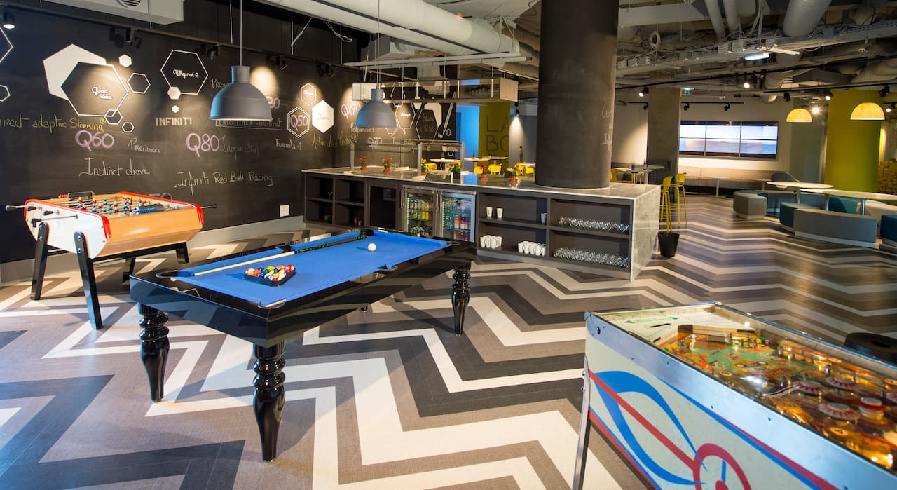 Le Campus Pool table and pinball machine in hotel games room