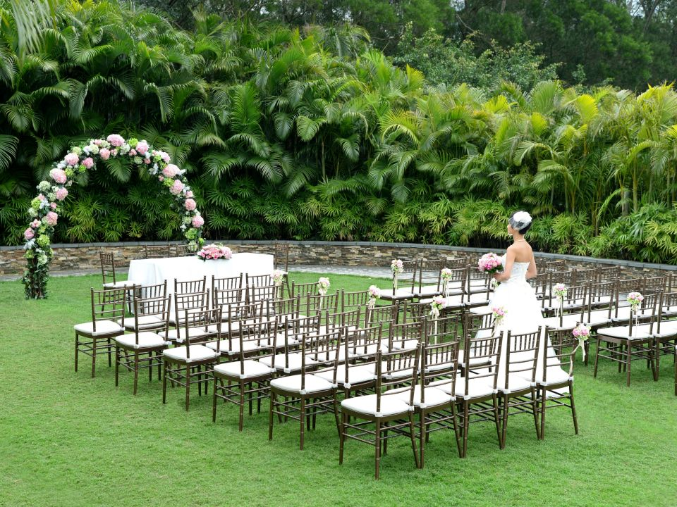 Garden Wedding Ceremony with Bronze Chairs