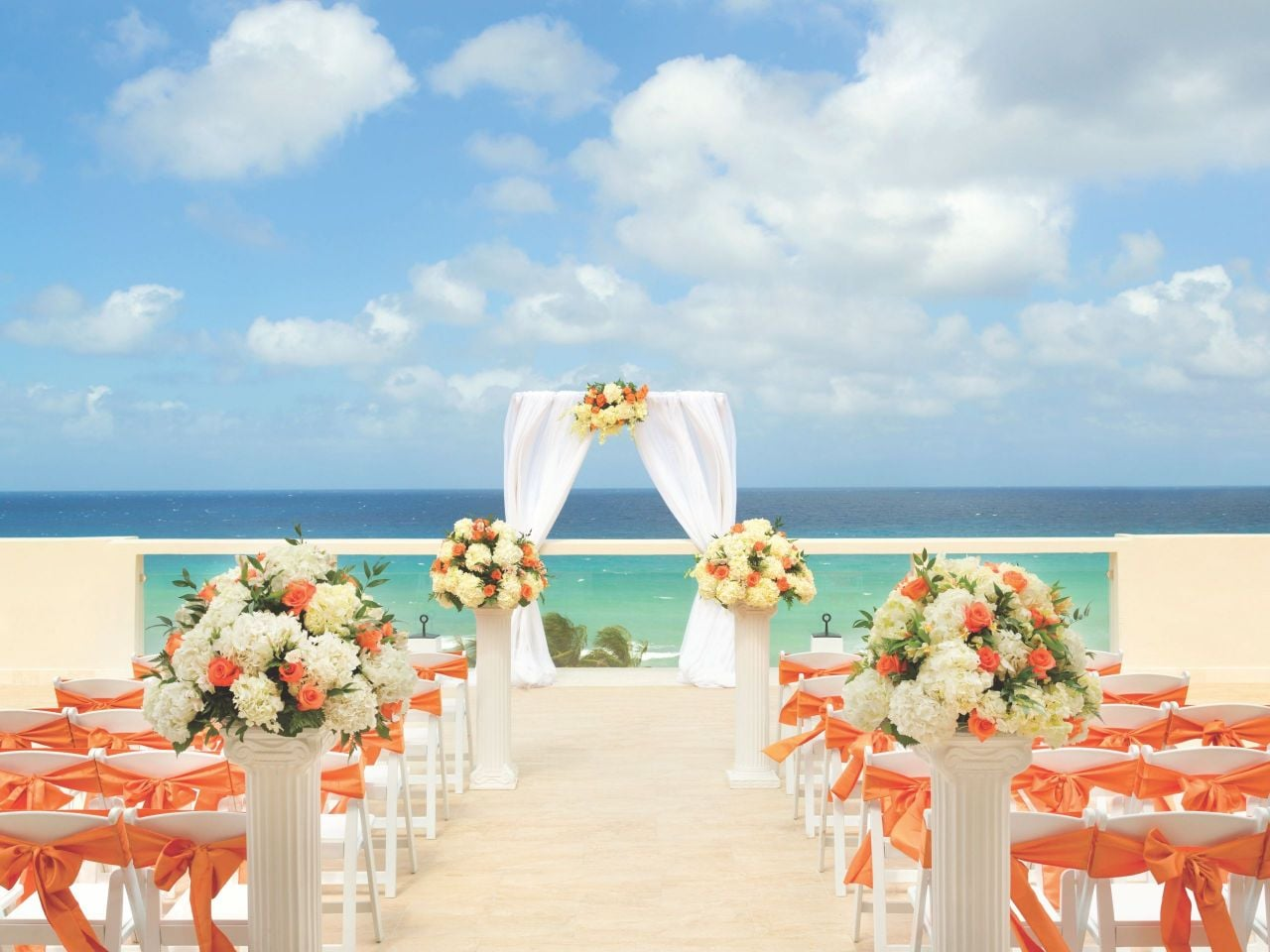 Wedding ceremony setup on resort beachfront
