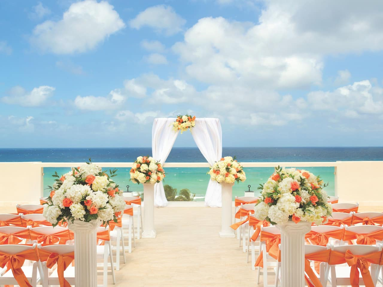 Wedding ceremony setup on resort beachfront