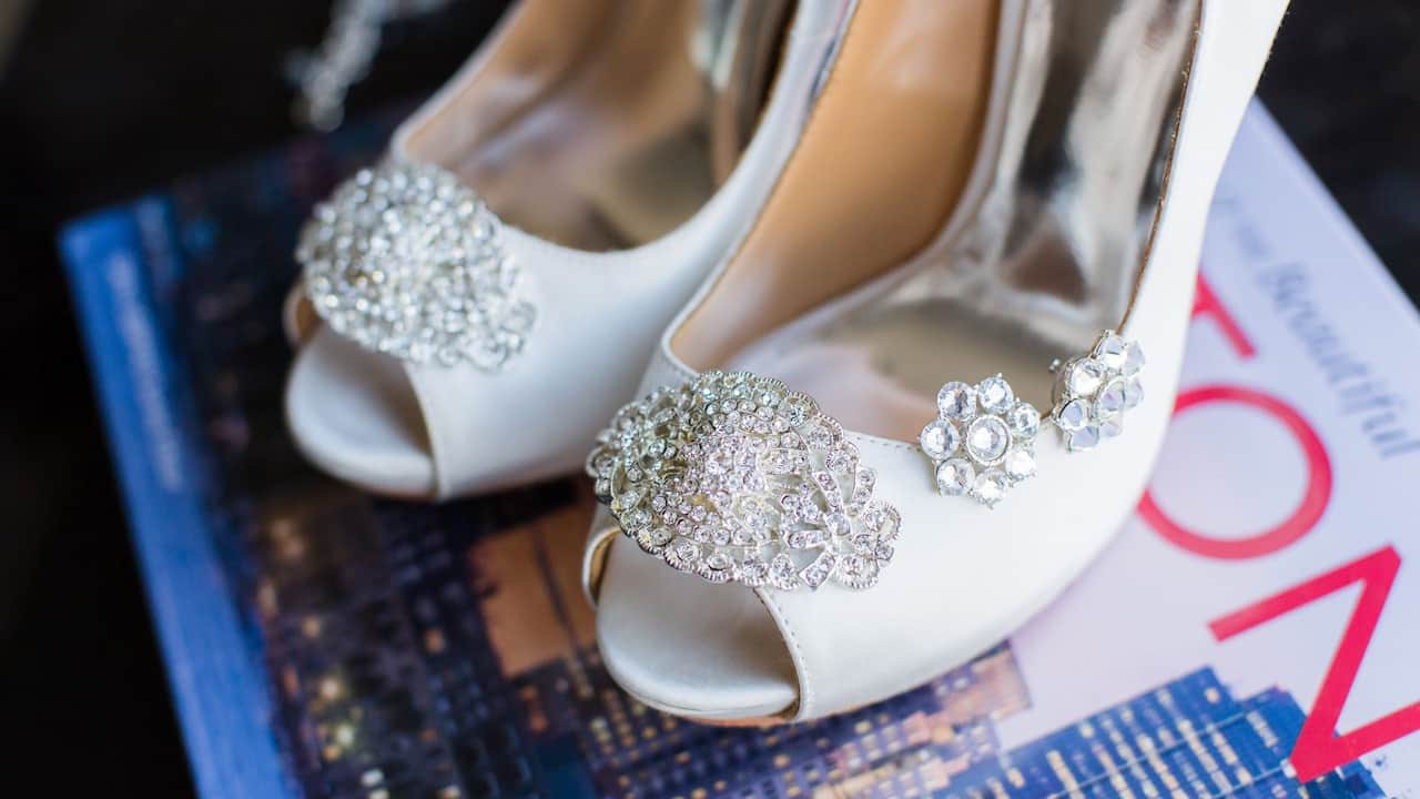 Bride's wedding shoes on top of Boston magazine