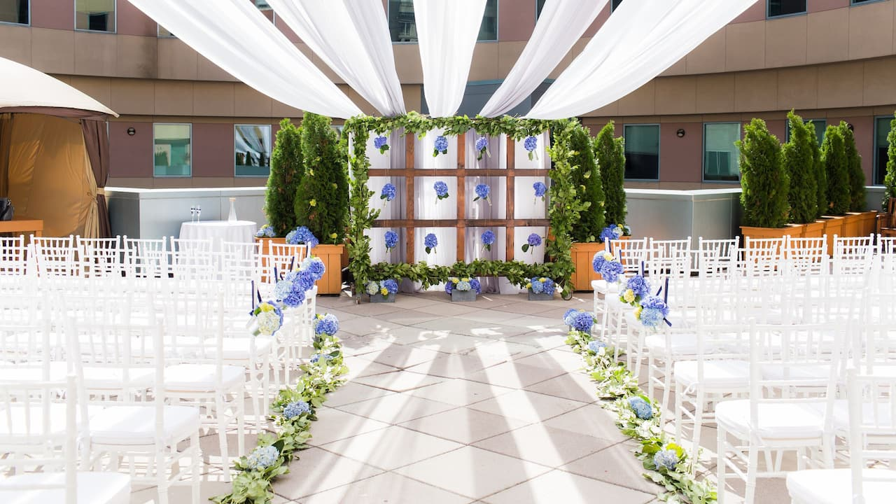 Wedding ceremony setup in hotel ballroom