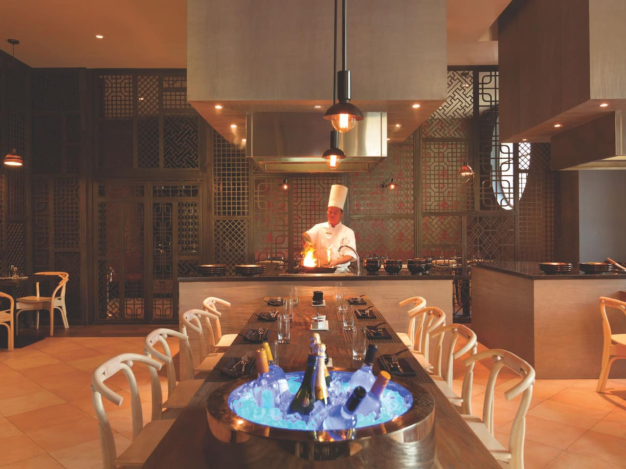 Chef cooking in open kitchen