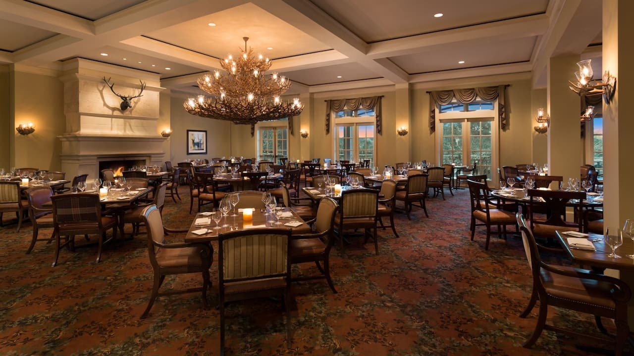 Antlers Lodge, A dinning space offered at Hyatt Regency Hill Country Resort & Spa
