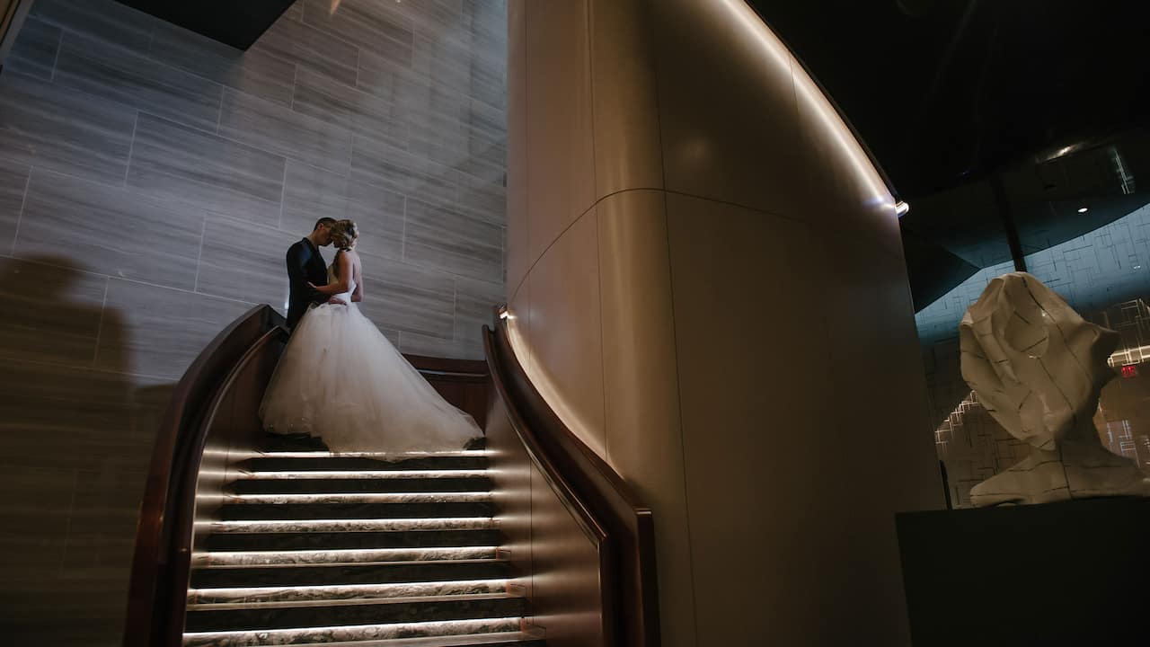 Park Hyatt New York: Bride and groom on staircase