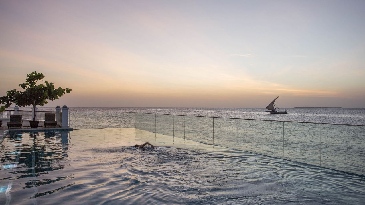 Infinity pool overlooking ocean sunset