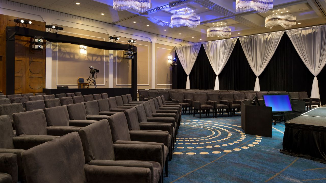 Spacious ballroom with elegant lighting and comfortable seating