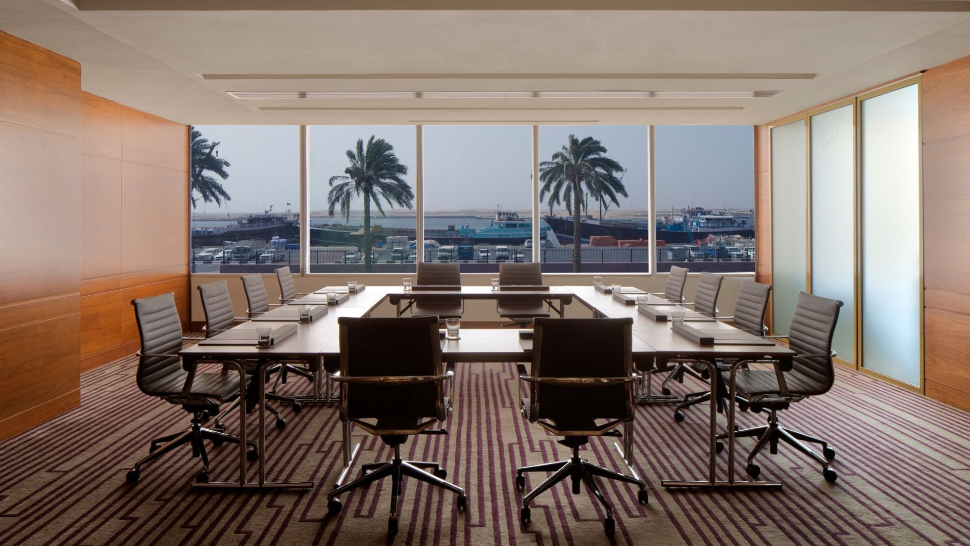 Chairs at large table in meeting room