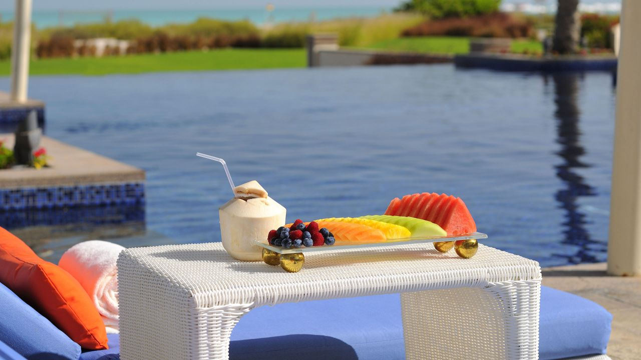 Pool cabana, fruit spread, umbrella drink