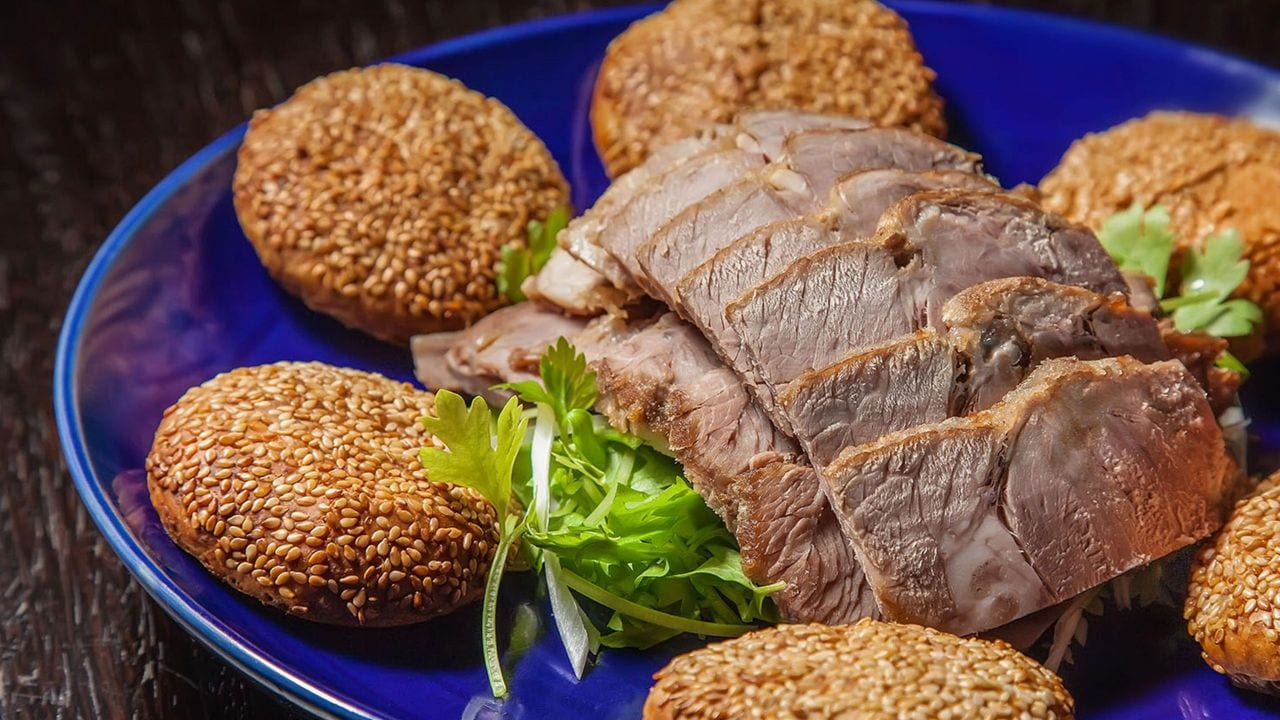 crispy lamb leg and sesame pancakes