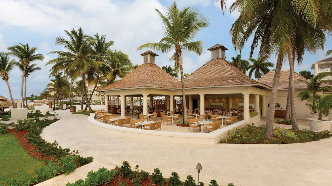 Palm trees surrounding tropical restaurant building