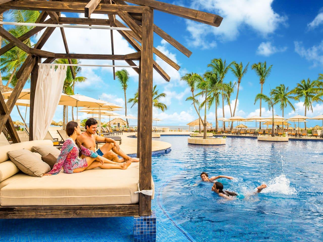 Family Enjoying Pool Cabana