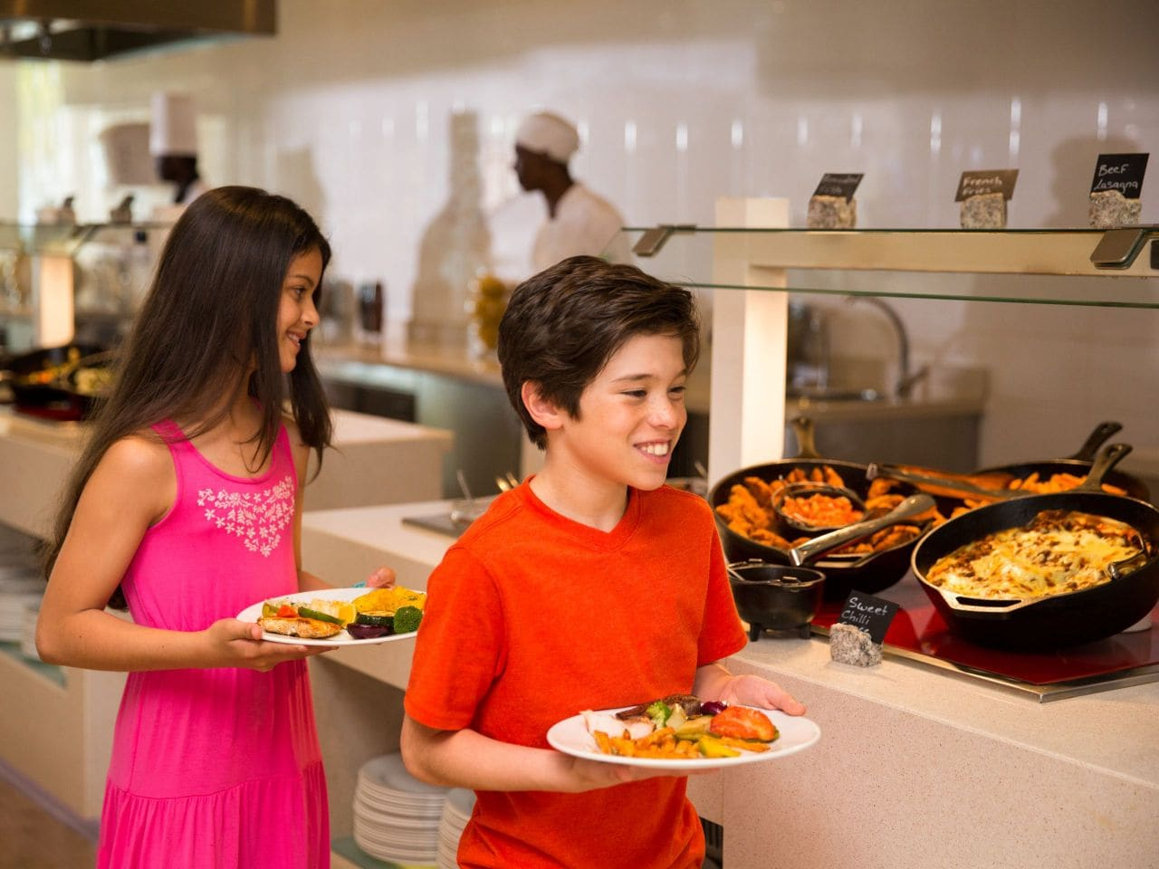 Kids with plates at food buffet at Hyatt Ziva Rose Hall