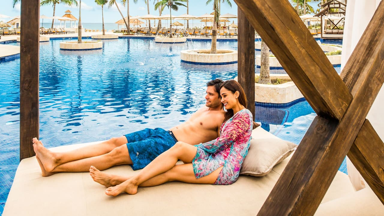 Couple in Pool Cabanas