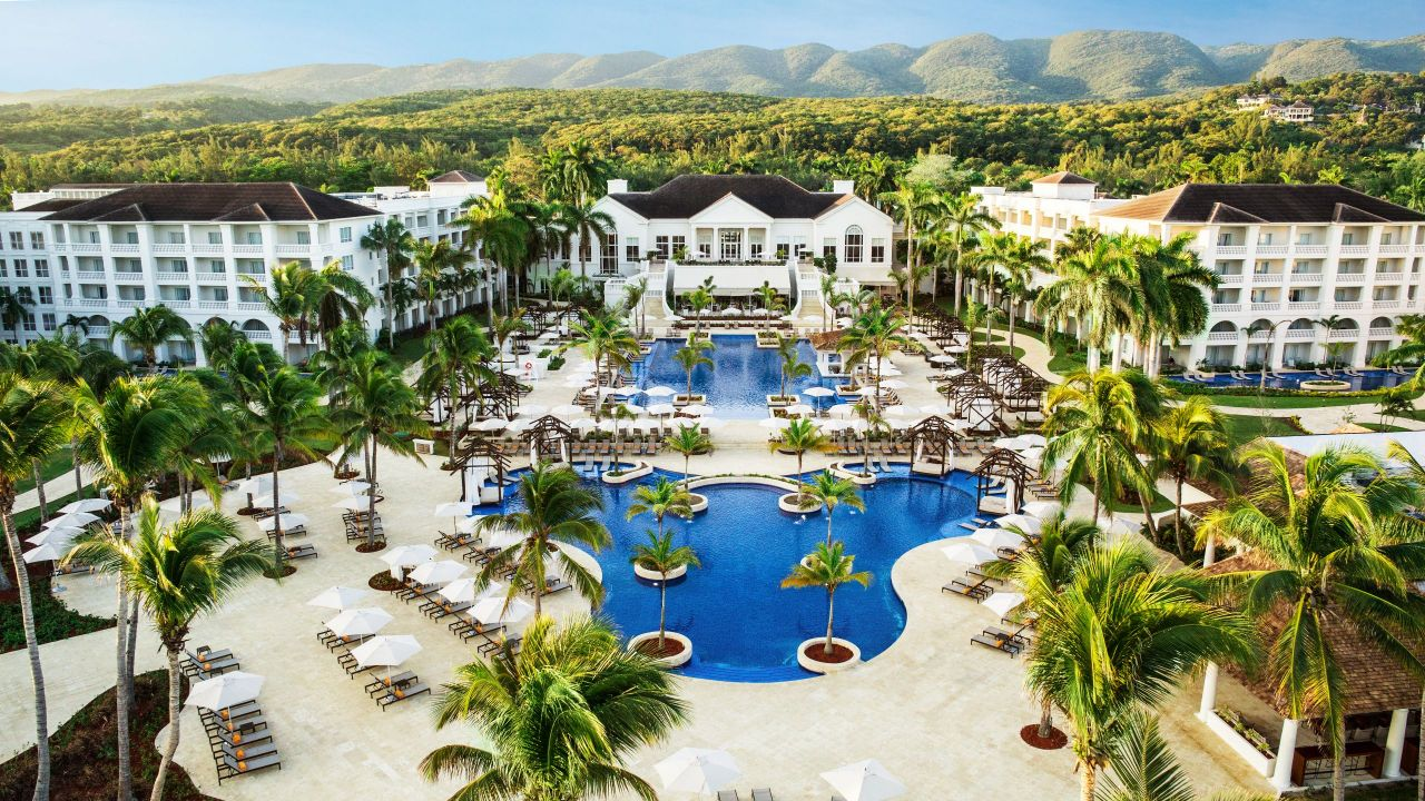 Aeriel view of white buildings, pools, and palm trees at Hyatt Ziva Rose Hall resort