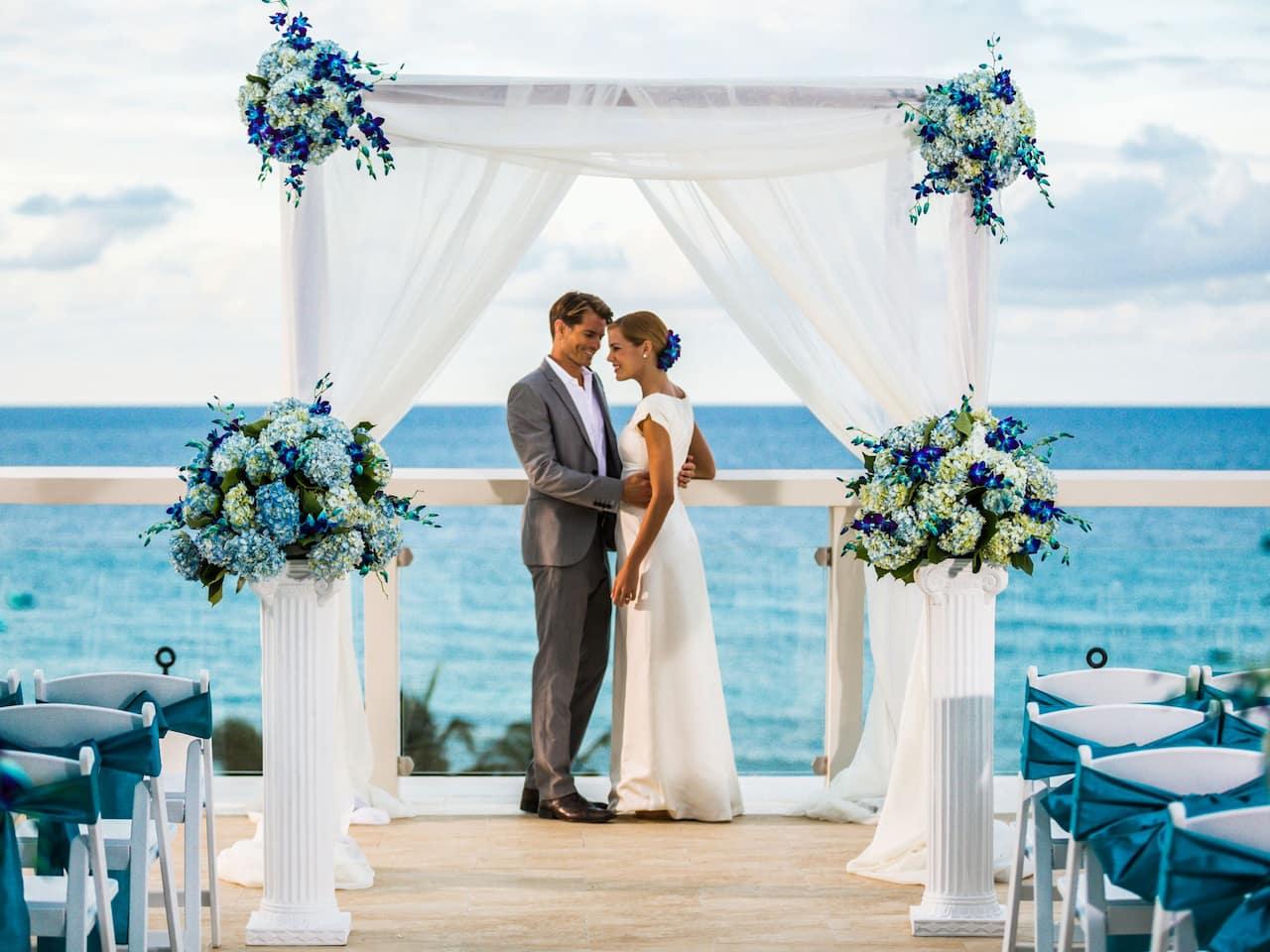 Bride and groom at beach wedding ceremony