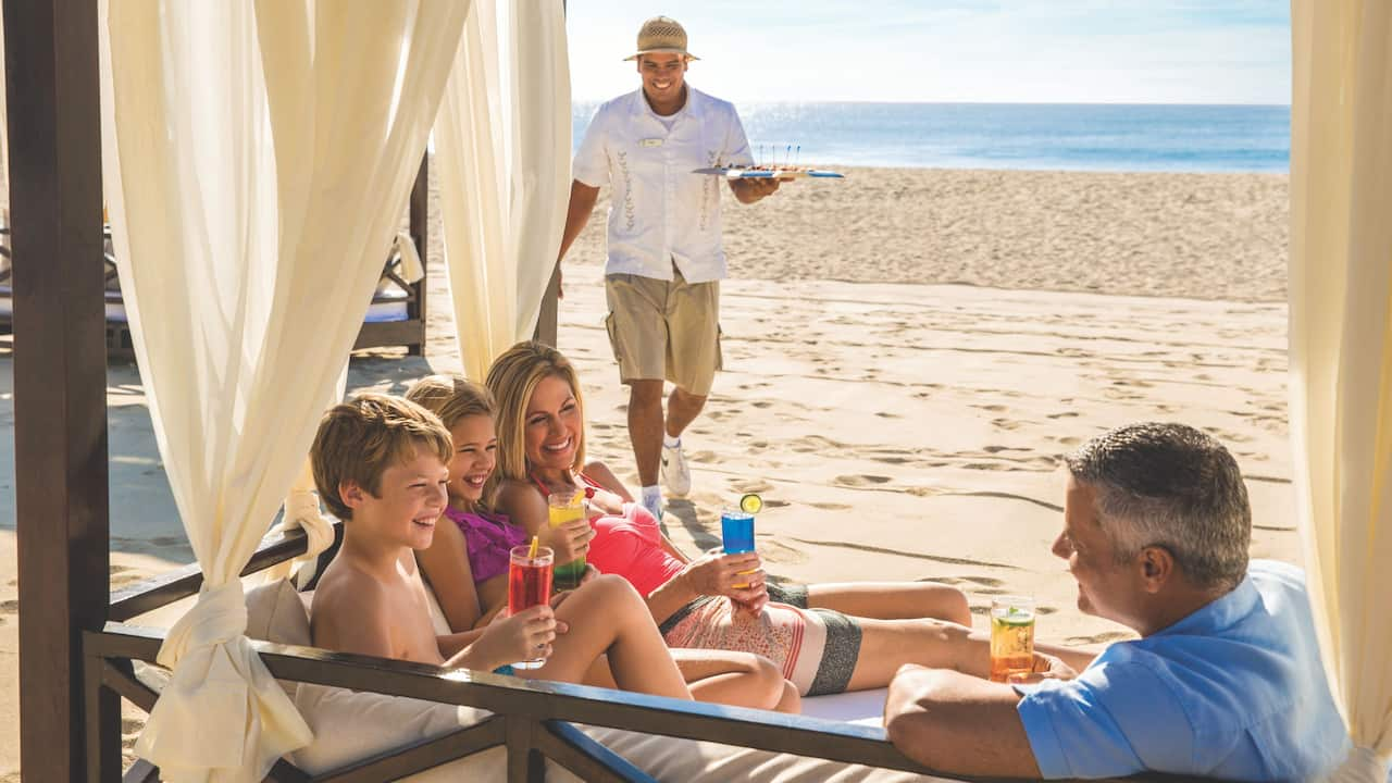 Family Having Drinks in their Beach Cabana