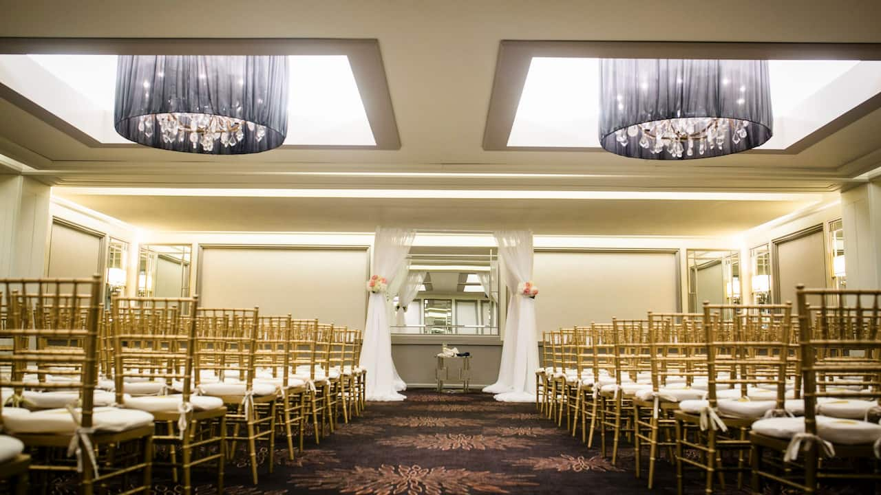 Wedding ceremony setup in hotel ballroom