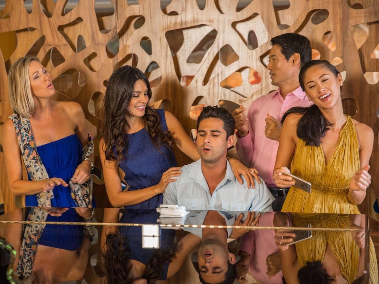 Friends Singing at the Lobby Bar