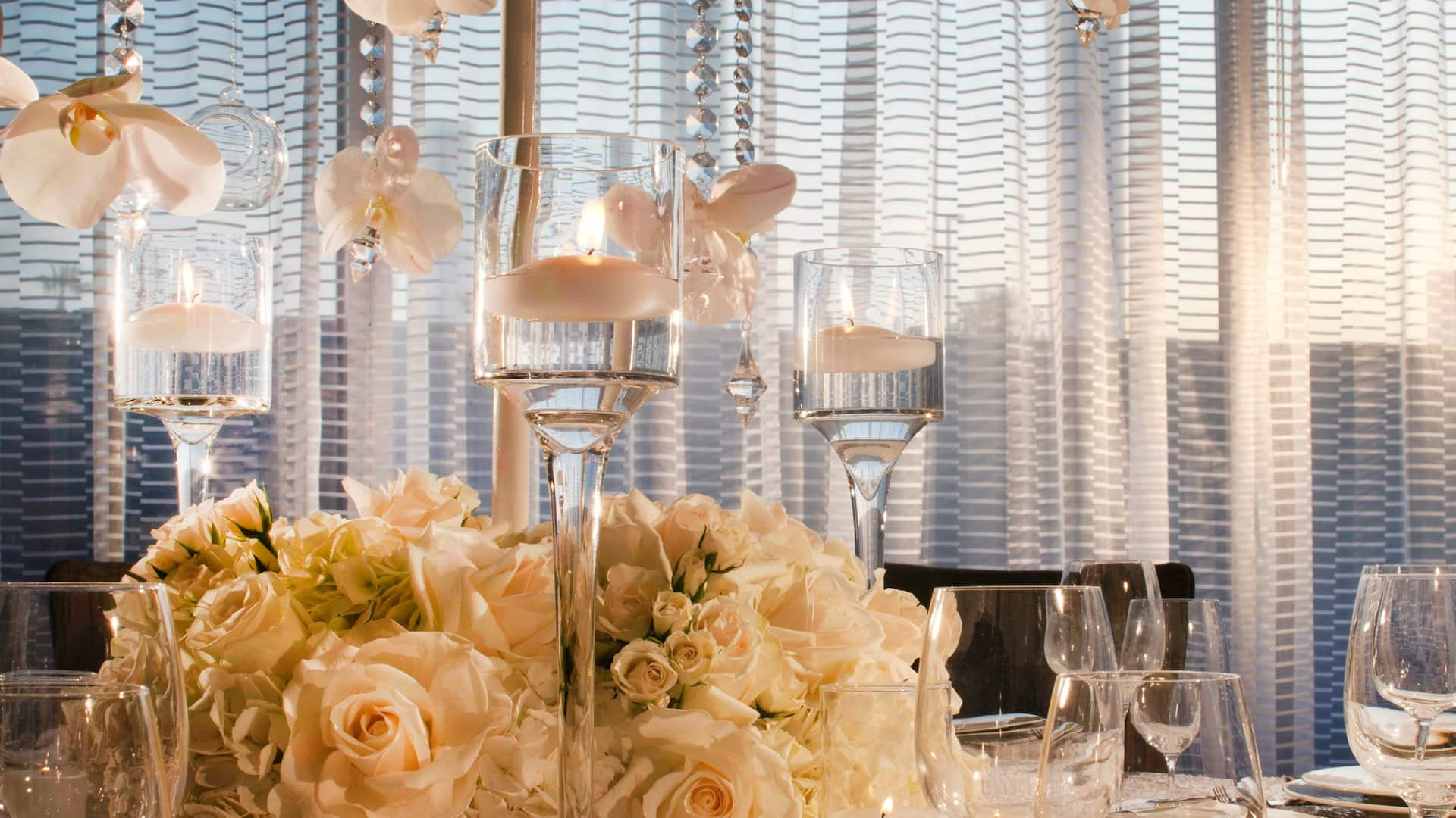 Table setting and floral arrangements for wedding