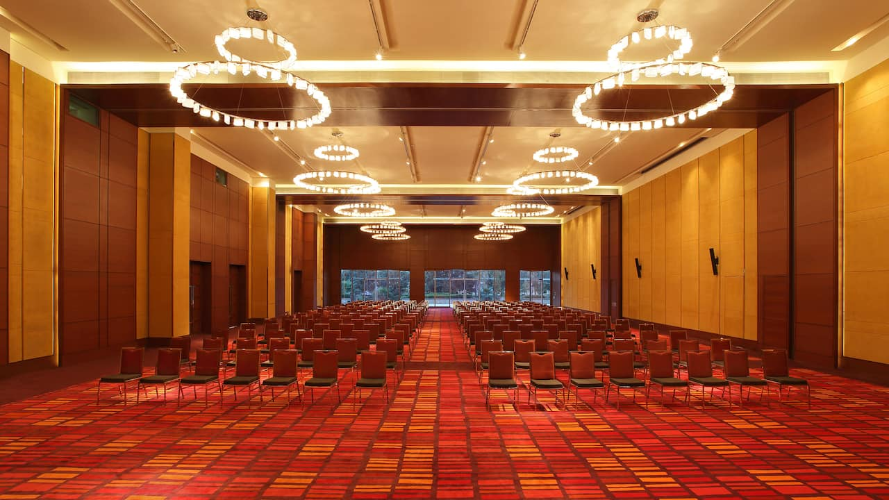 Hotel ballroom with chairs on red carpet
