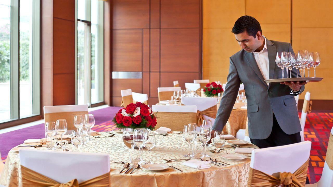 Waiter setting large round table