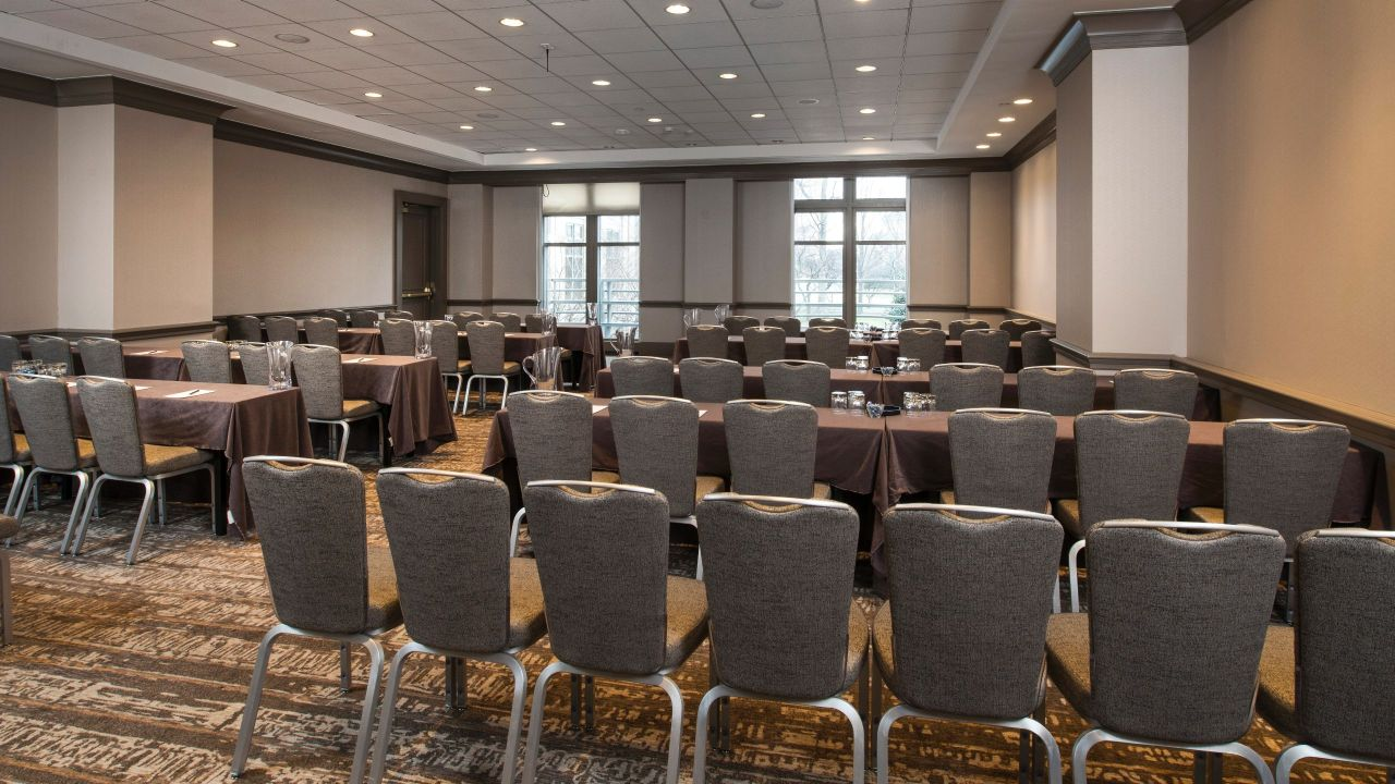 Rows of chairs in hotel meeting room