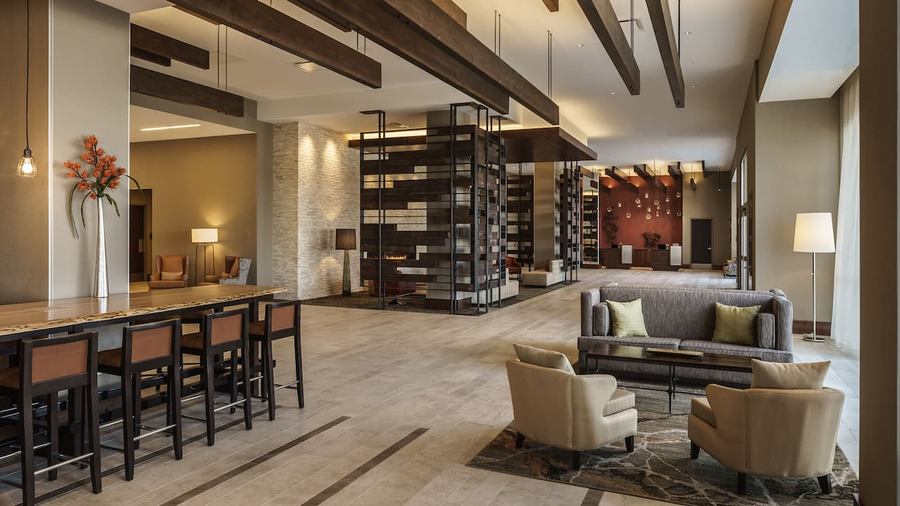 Armchairs, sofas, and tables in hotel lobby