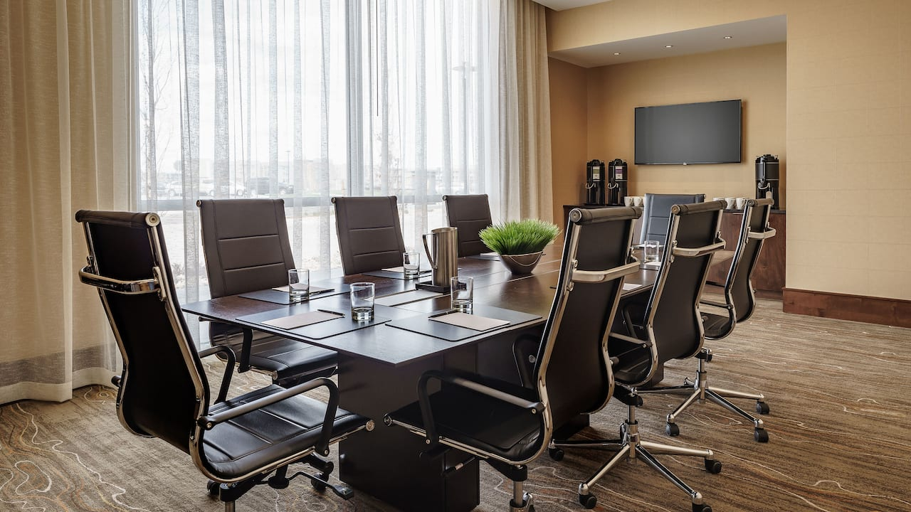 Leather office chairs around long table in hotel boardroom