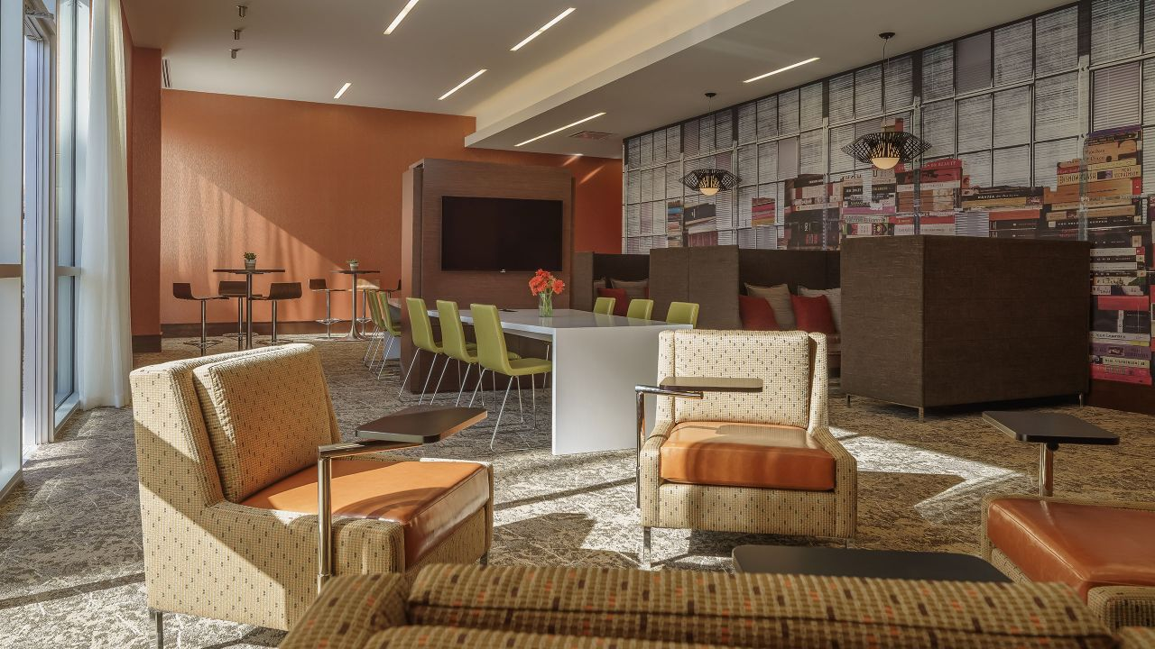 Armchairs, sofas, and tables in hotel lounge