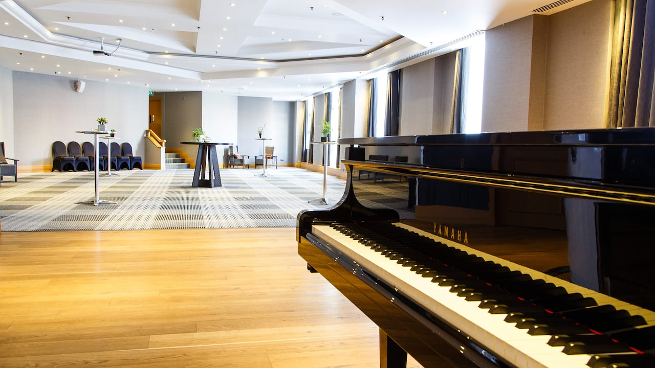 Sonata room reception set up with piano at Hyatt Regency Birmingham